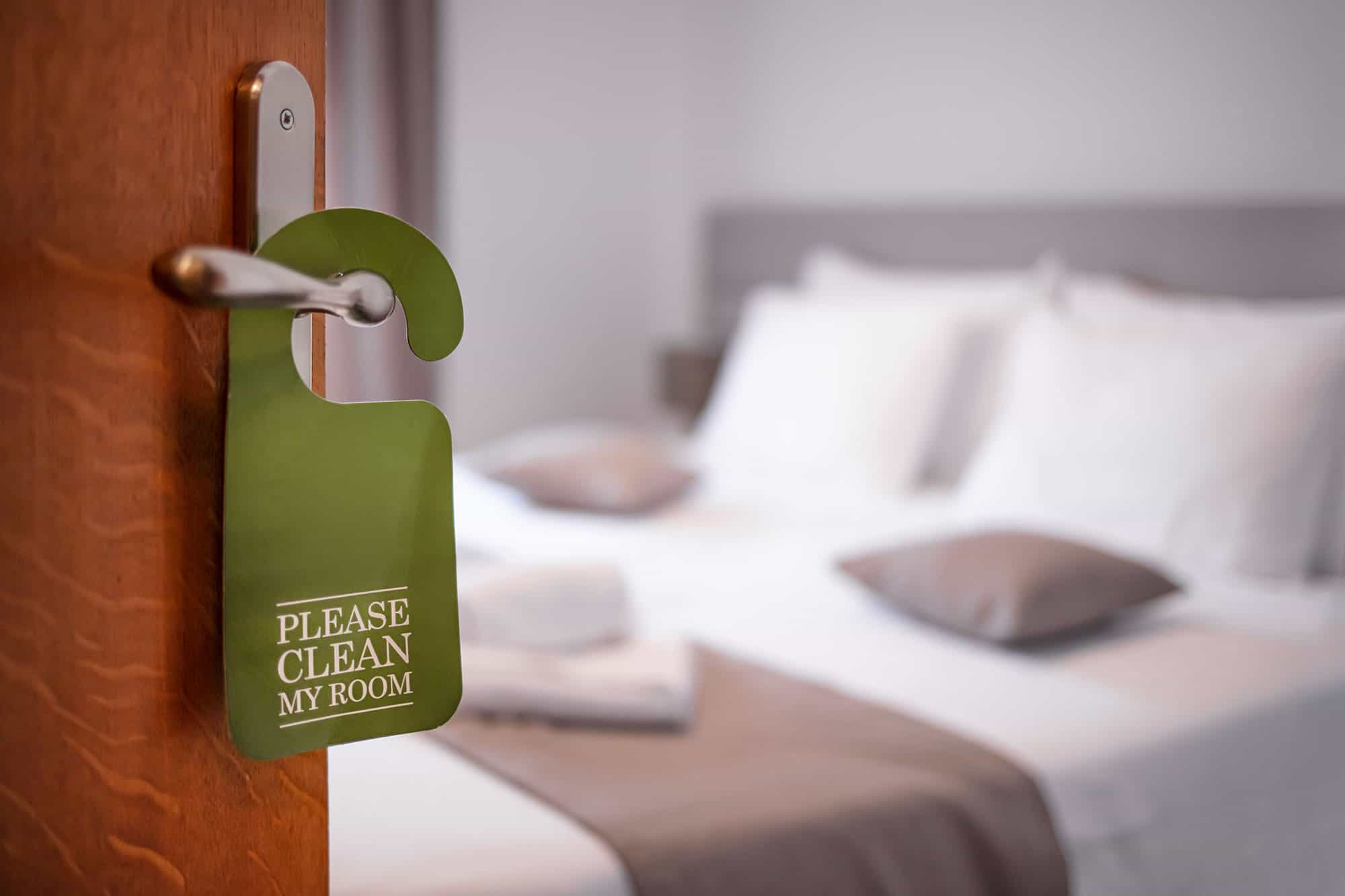 planning around hotel service quality issues, image of room clean tag on open door in hotel